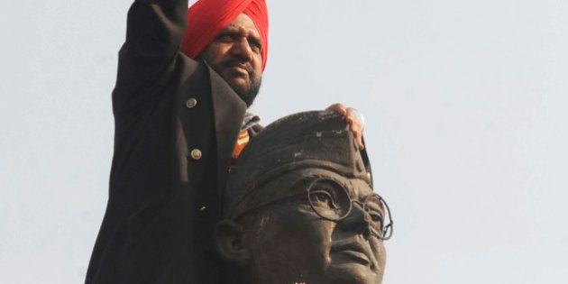 Member of the All India Azad Hind Fauj Freedom-Fighters Successors Association ,Tarsem Singh, gestures on the statue of freedom fighter, Subash Chandra Bose, in Amritsar, on January 23, 2011, as part of celebrations for his 114th birth anniversary. Bose known as Netaji, was the leader of the movement to free India from Birtish rule and commanded the Indian National Army during World War II. AFP PHOTO/NARINDER NANU (Photo credit should read NARINDER NANU/AFP/Getty Images)