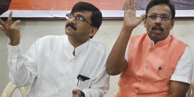 MUMBAI, INDIA - SEPTEMBER 23: (R- L) BJP Leader Vinod Tawde and Shiv Sena spokesman Sanjay Raut addressing...
