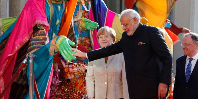 German Chancellor Angela Merkel, center, welcomes India's Prime Minister Narendra Modi, second right,...