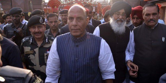 Union Home Minister Rajnath Singh (C), Punjab state chief minister Parkash Singh Badal (2R) and Border...
