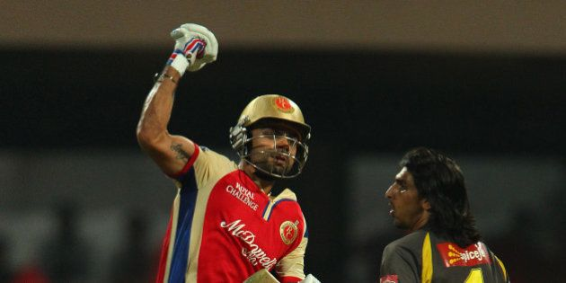 Virat Kohli celebrates the win during match 9 of of the Pepsi Indian Premier League between The Royal...