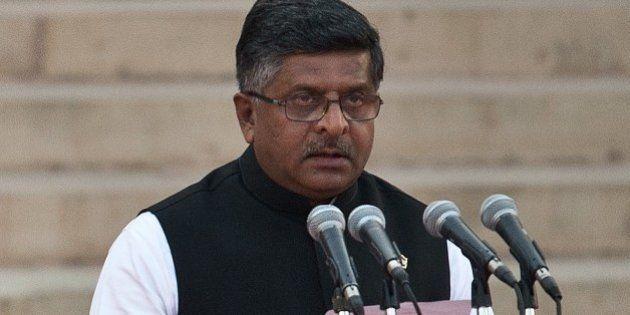 In this photograph taken on May 26, 2014, Bharatiya Janata Party (BJP) leader Ravi Shankar Prasad takes...