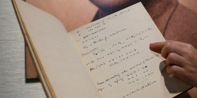 FILE - In this March 19, 2015, file photo, a page from the notebook of British mathematician and pioneer...
