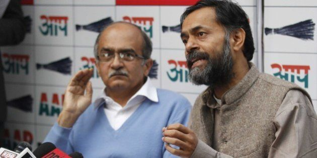 NEW DELHI, INDIA - DECEMBER 18: Aam Aadmi Party leaders Yogendra Yadav (R) with Prashant Bhushan during...