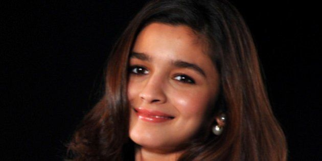 Indian Bollywood actress Alia Bhatt poses for a photograph during a promotional event in Mumbai on late...
