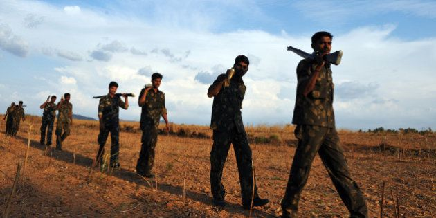 Indian Special Security Force personnel deployed for anti-Naxal operations perform a security sweep near...