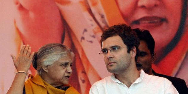 General Secretary of India's Congress Party Rahul Gandhi (R) speaks with Chief Minister of Delhi Sheila...