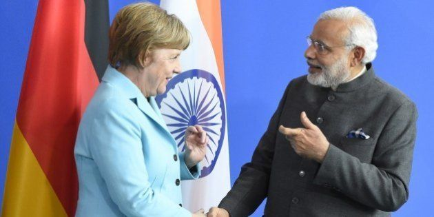 German Chancellor Angela Merkel and Indian Prime Minister Narendra Modi shake hands after a news conference...