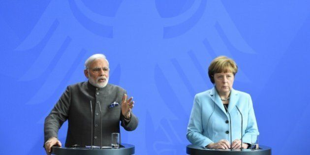 German Chancellor Angela Merkel and Indian Prime Minister Narendra Modi address a press conference on...