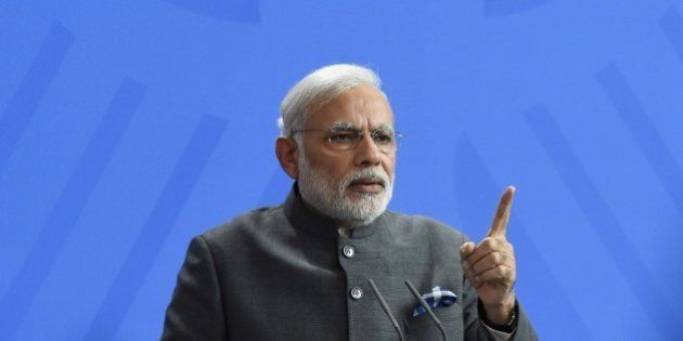 Indian Prime Minister Narendra Modi gestures during a press conference after talks with the German Chancellor...