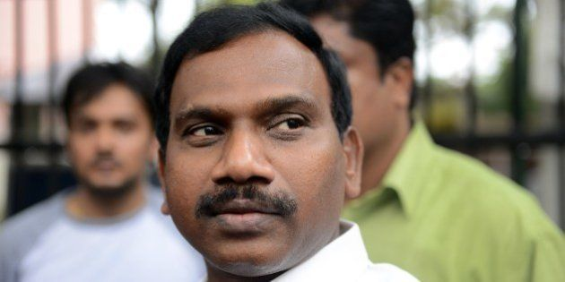 Former telecom minister A. Raja gesture as he interacts with the media following his appearance in connection...