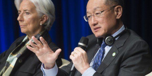 World Bank Group President Jim Yong Kim (R) speaks as International Monetary Fund (IMF) Managing Director...