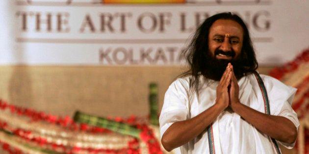 Indian spiritual guru and founder of The Art of Living Foundation Sri Sri Ravi Shankar greets followers...