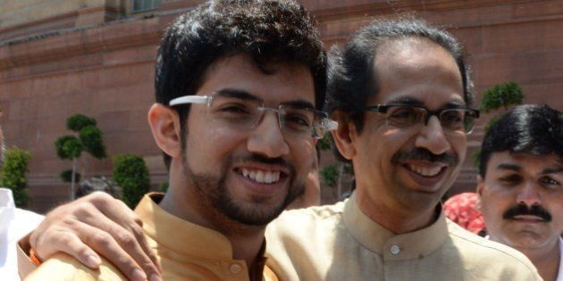 Shiv Sena leader Udhav Thakre (R) and his son Aditya arrive at Parliament house in New Delhi on May 20,...