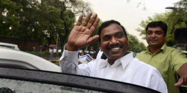 Former telecom minister A. Raja gestures as he leaves after he appeared in connection with the 2G spectrum...