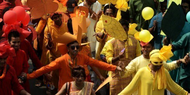 Bangladeshi revellers march during a rally in celebration of the Bengali New Year, or Pohela Boishakh,...