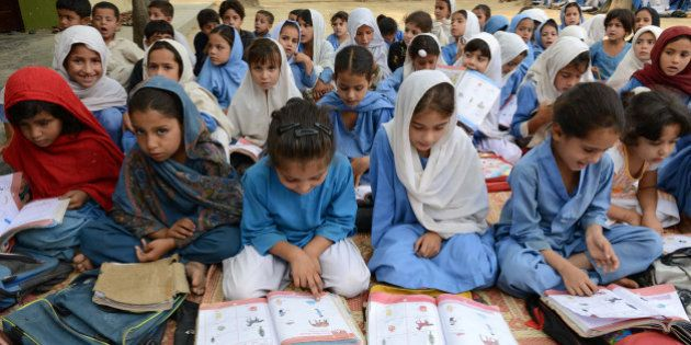Pakistani girls attend class at a school in Mingora, a town in Swat valley, on October 9, 2013, the first...