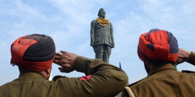 Indian Punjab police salute the statue of freedom fighter, Netaji Subhash Chandra Bose in Amritsar on...