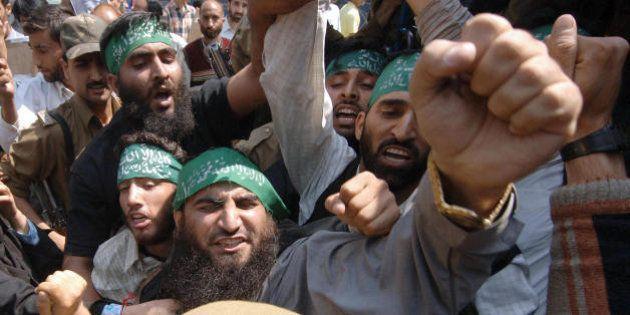 SRINAGAR, INDIA: Chairman of the pro-Pakistan Muslim League Jammu Kashmir (MLJK) Masarat Alam (C) is...