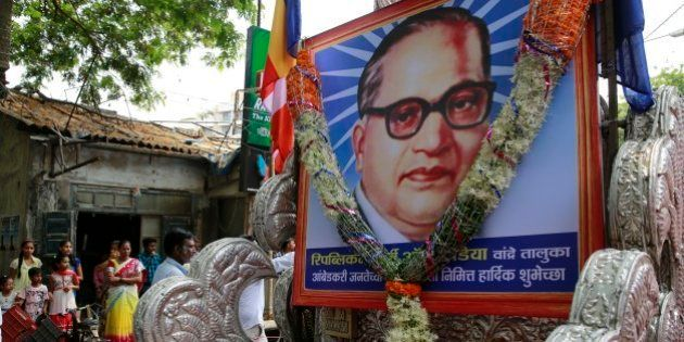 Indians watch a procession to mark the birth anniversary of Bhim Rao Ambedkar in Mumbai, India, Tuesday,...
