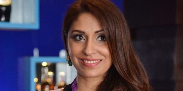 Indian model Pooja Misrra (C) poses during the launch of her calender at a hotel in Amritsar on March...