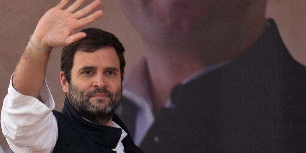 India's opposition Congress party Vice President Rahul Gandhi waves to the crowd during an election campaign...