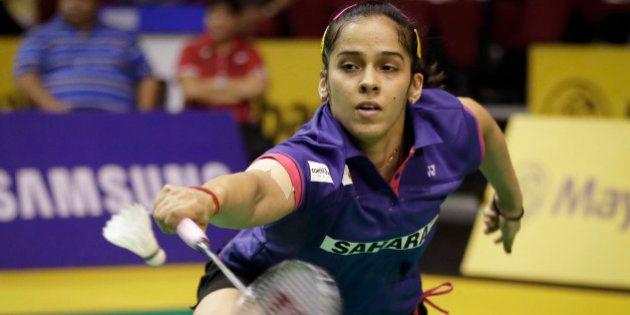 India's Saina Nehwal returns a shot to China's Sun Yu during their women's singles quarterfinal match...