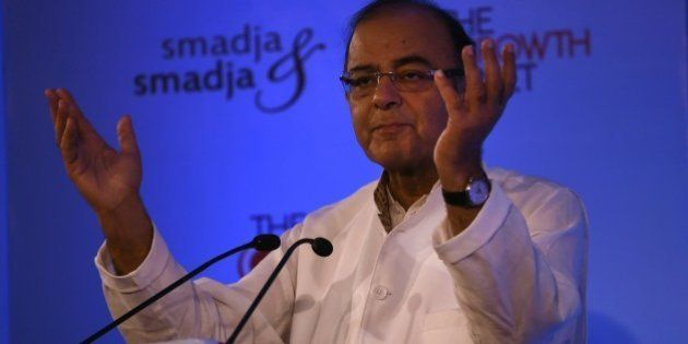 India's Finance Minister Arun Jaitley gestures as he speaks during the third annual Growth Net summit...
