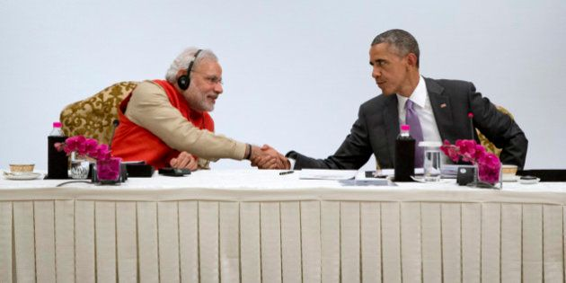 U.S President Barack Obama, right, shakes hands with Indian Prime Minister Narendra Modi as they participate...