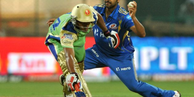 Royal Challengers Bangalore batsman Mayank Agarwal (L) makes it to the crease while Mumbai Indians bowler...