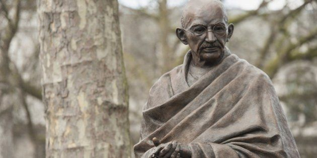 A recently unveiled statue of Mahatma Gandhi is seen in Parliament square in central London on March...
