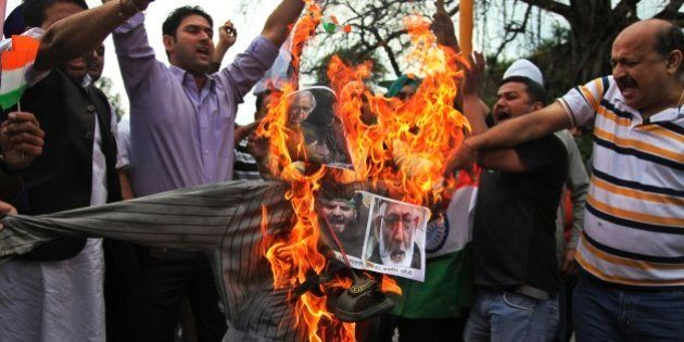 India's Hindu right-wing activists prepare to burn an effigy of an effigy with pictures of Jammu and...