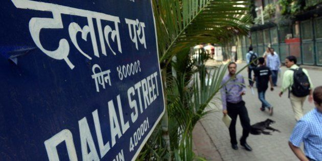 Indian pedestrians walk on Dalal Street - Trader's Street - next to the Bombay Stock Exchange (BSE) in...
