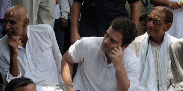 Congress General Secretary Rahul Gandhi (C) listens to farmers during his visit to Nangla Bhatana village...