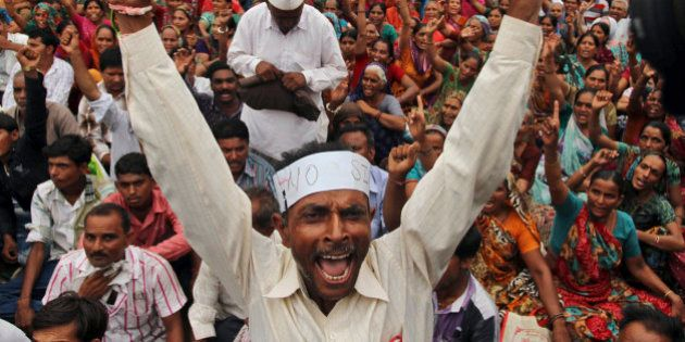 An Indian farmer shouts slogans during a protest rally in Gandhinagar, 30 kilometers (19 miles) north...