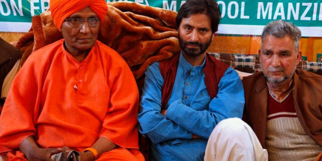 Chairman of the Jammu Kashmir Liberation Front (JKLF) Yasin Malik, center, sits for a 30-hour- long hunger...