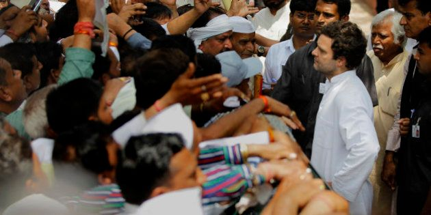 Congress party Vice President Rahul Gandhi interacts with farmers outside his residence in New Delhi,...