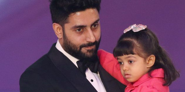 Abhishek Bachchan and daughter Aaradhya Bachchan, during the Miss World 2014 final, on stage at the Excel...