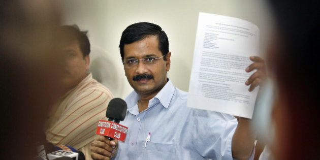 NEW DELHI, INDIA - OCTOBER 27: AAP Chief Arvind Kejriwal showing press release during the press conference...
