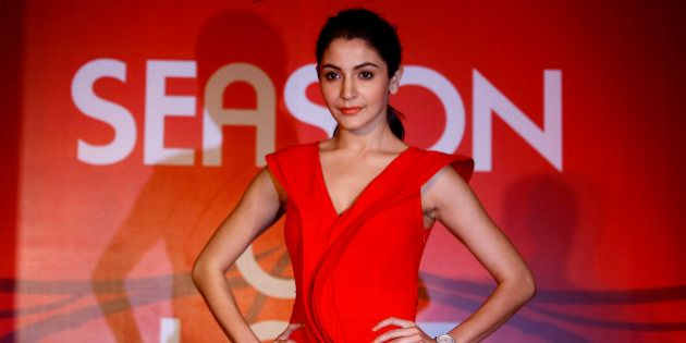Bollywood actress Anushka Sharma poses for photos during a promotional event of a jewelry in Mumbai,...