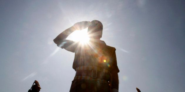 A Jammu and Kashmir state police officer salutes during a function to mark Police Commemoration Day,...