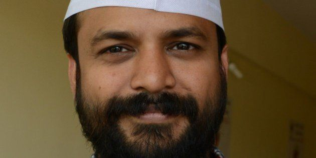 Investigative-journalist turned Aam Admi Party (AAP) candidate from Delhi Ashish Khetan poses at the...
