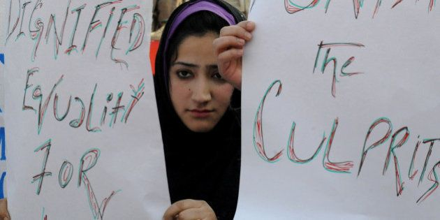 Kashmiri students hold placards and banners during protest in Srinagar on January 10, 2013. The students...