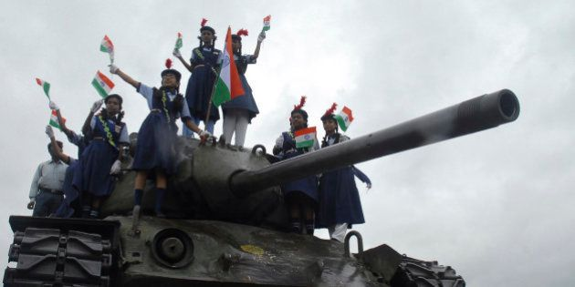 School children wave Indian national flag on top of an Indian army tank to celebrate Kargil Victory Day...