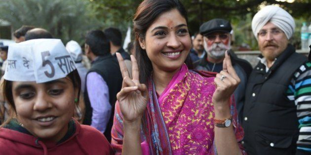 Senior Leader of India's Aam Aadmi Party (AAP) Alka Lamba (C) gestures as she arrives for a meeting in...