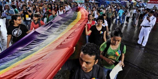 Lesbian, Gay, Bisexual and Transgender (LGBT) activists hold a rainbow flag as they participate in the...