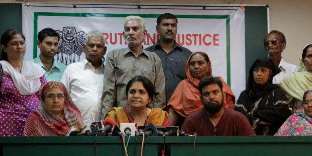 Citizens for Justice and Peace (CJP) founder Teesta Setalvad, center, addresses a press conference as...