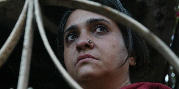 Indian human rights activist Teesta Setalvad listens as residents of The Gulbarg Society describe events...