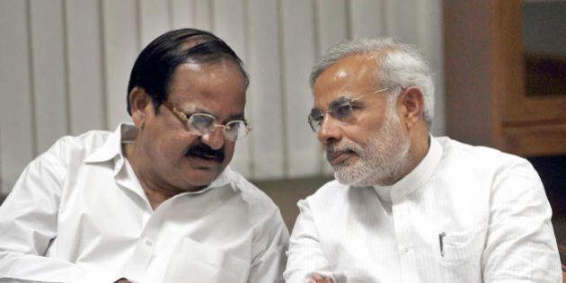 Bharatiya Janata Party (BJP) senior BJP leader M. Venkaiah Naidu (L) talks with Gujarat Chief Minister...