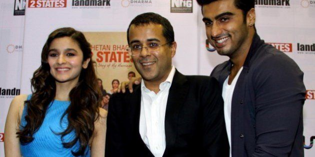Indian author Chetan Bhagat (C) poses with Indian Bollywood actors Alia Bhatt (L) and Arjun Kapoor (R)...